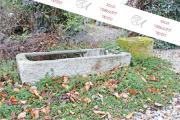 Ein altes Brunnenbecken, Granitstein